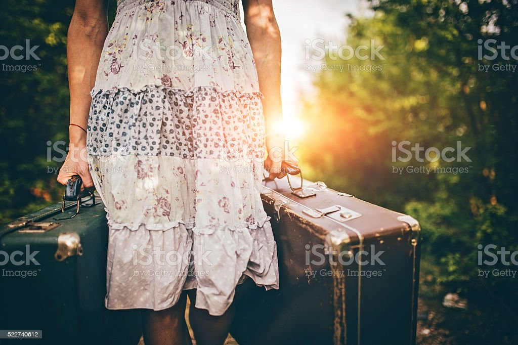 Woman carries bags stock photo