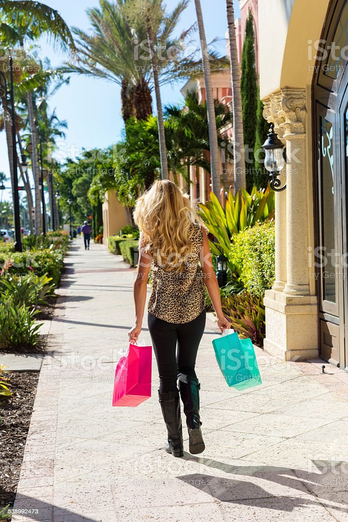 Woman Carries Her Shopping Bags on 5th Avenue stock photo