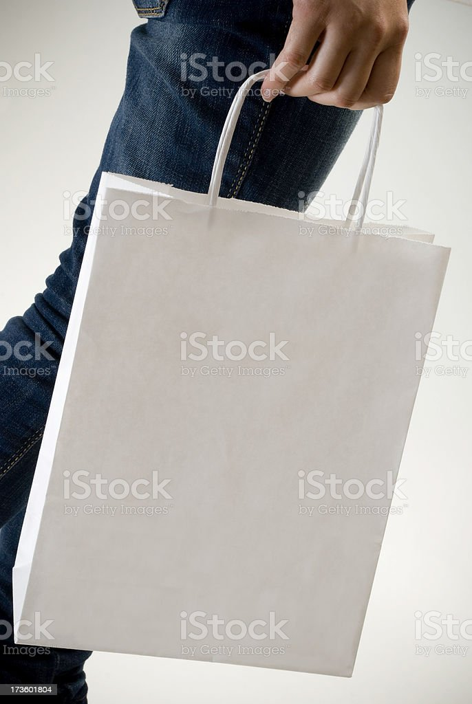 Woman carrying a bag royalty-free stock photo