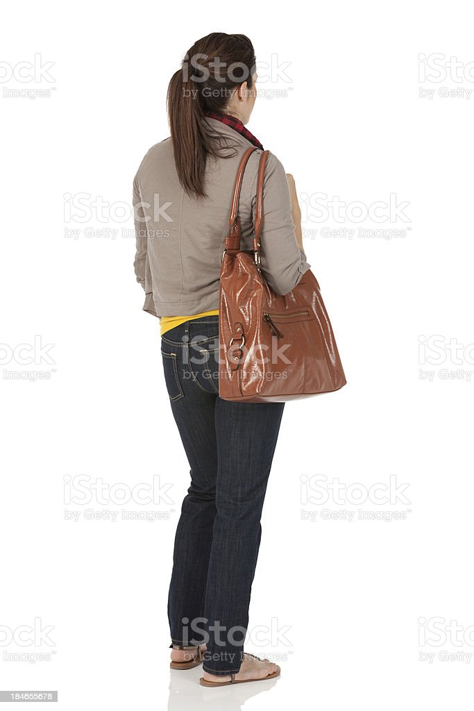 Woman carrying a bag stock photo