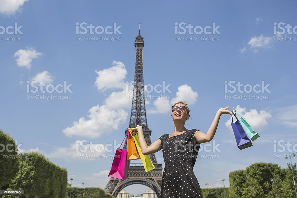 Woman carrying bags in front of Eiffel tower, Paris royalty-free stock photo