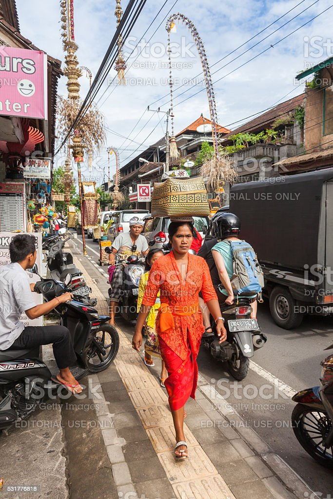 Woman carrying basket on the head stock photo