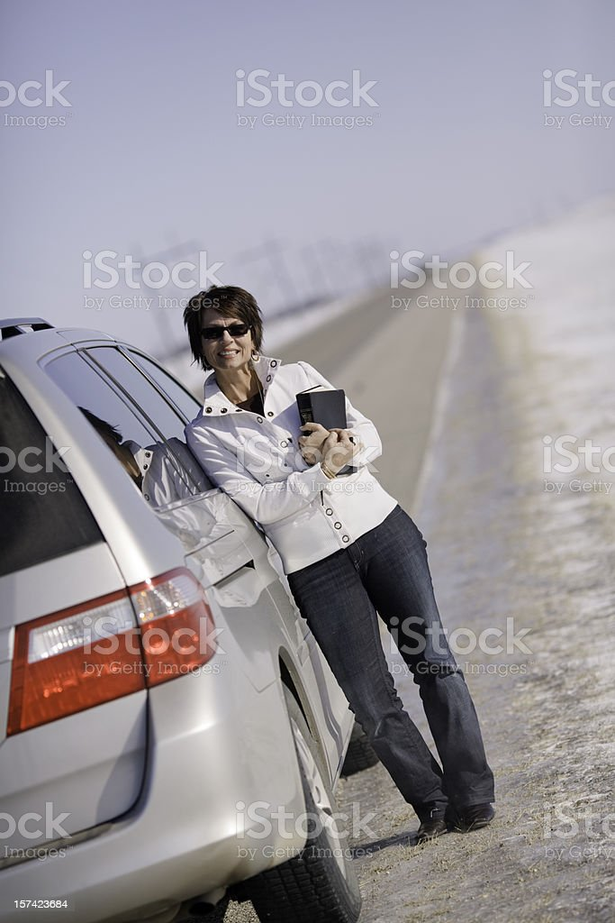 Woman carrying Bible by vehicle royalty-free stock photo