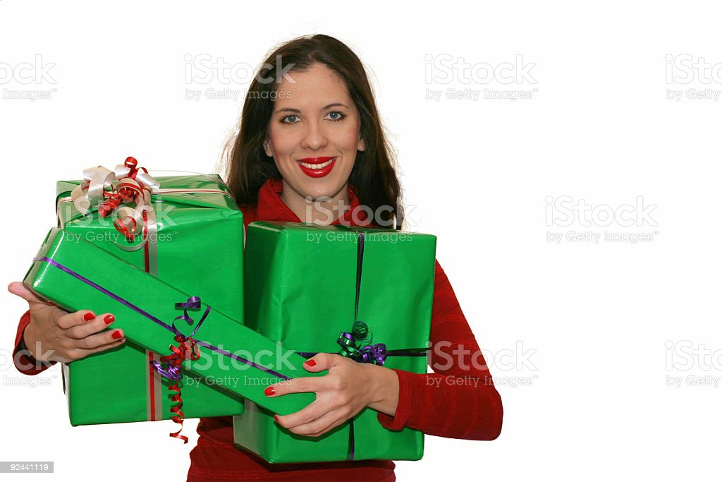 Woman carrying gifts royalty-free stock photo