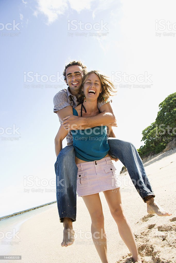 Woman carrying man. stock photo