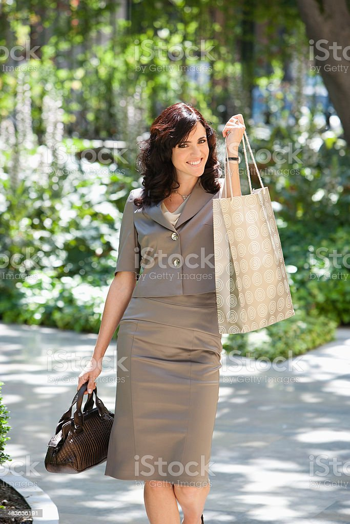 Woman carrying shopping bag stock photo
