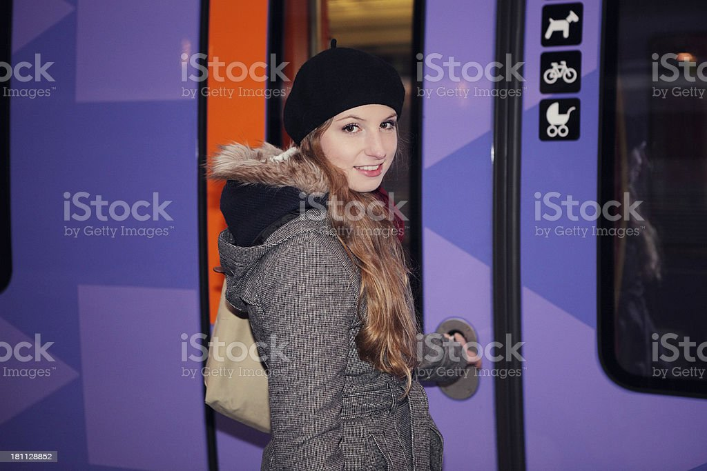 Woman catching train royalty-free stock photo