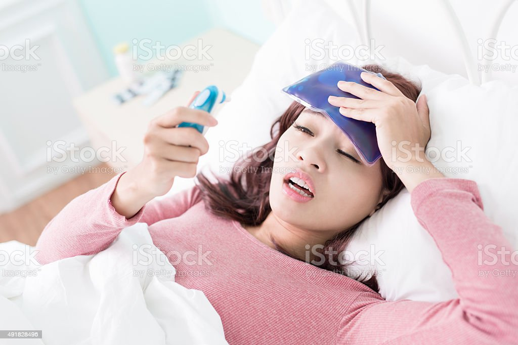 Woman caught Cold and fever stock photo