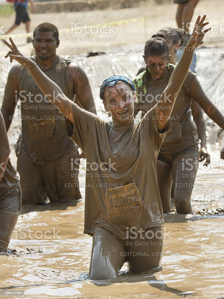 Woman celebrates at the end of a race stock photo