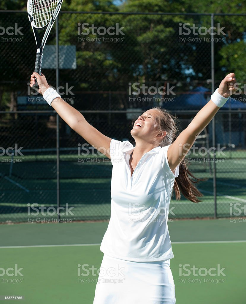 Woman celebrating a victory royalty-free stock photo
