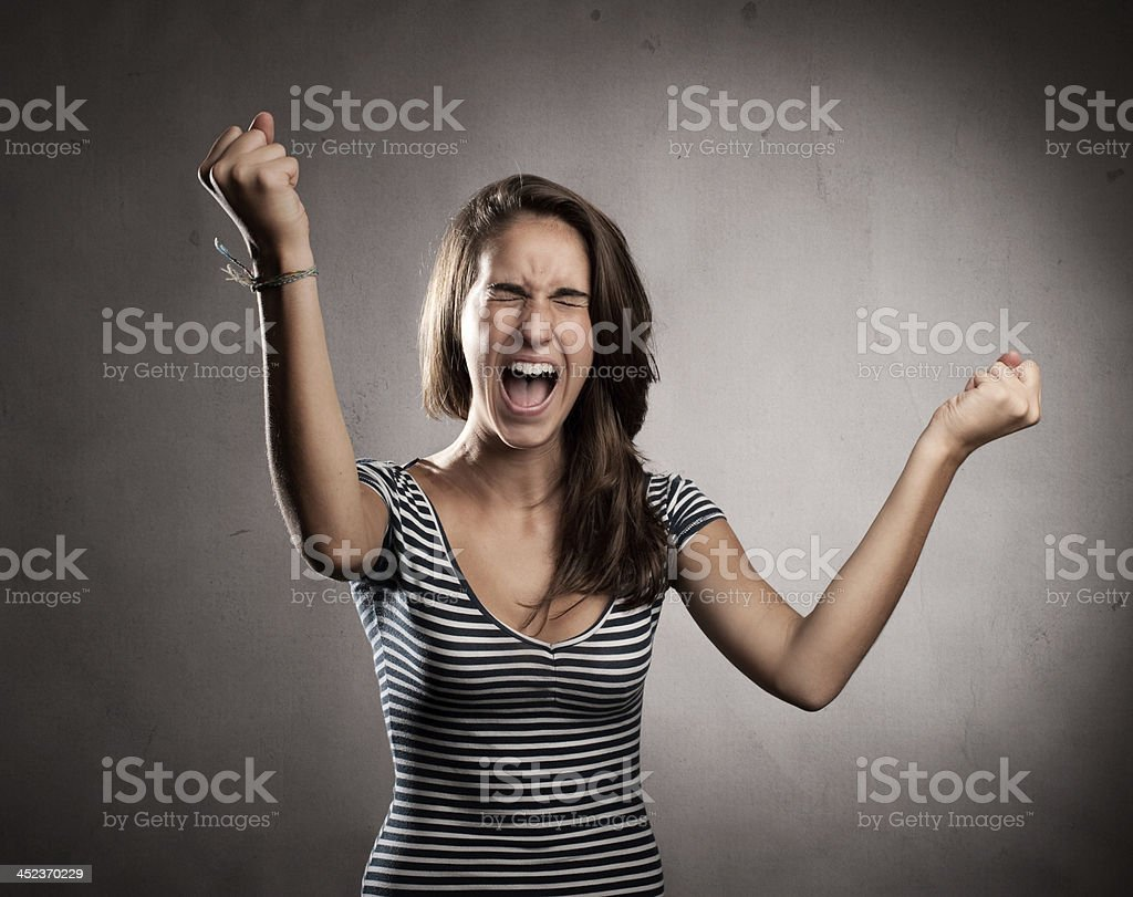 woman celebrating being a winner stock photo