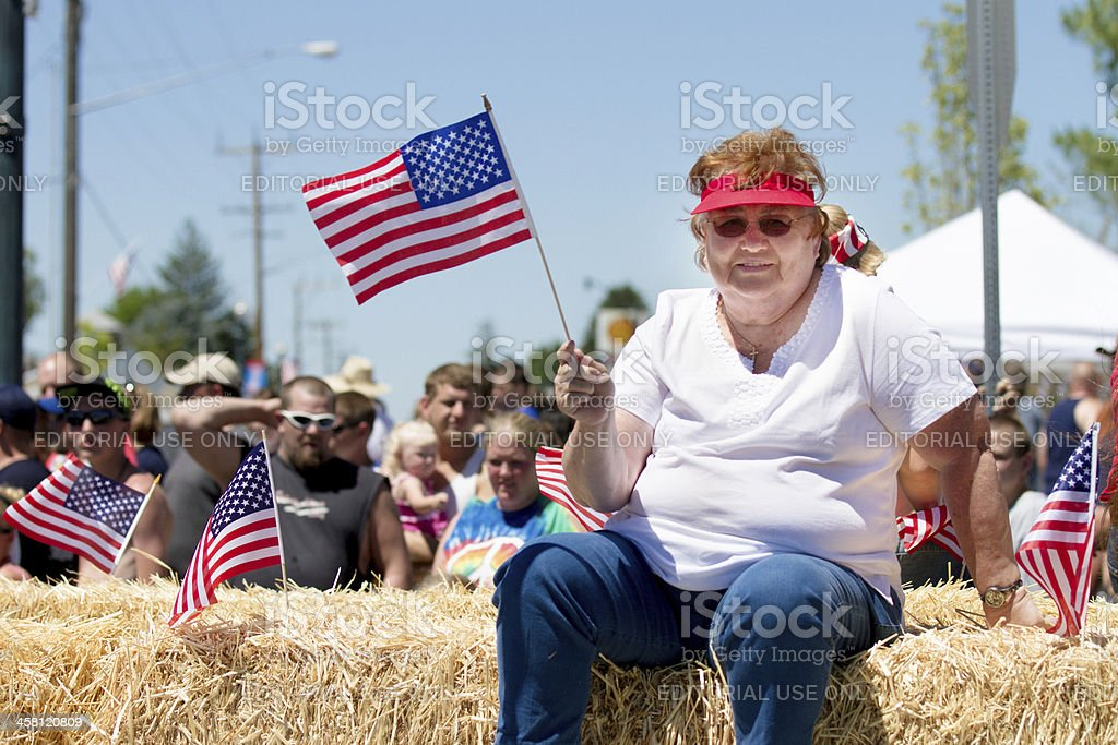 Woman celebrating the 4th of july stock photo