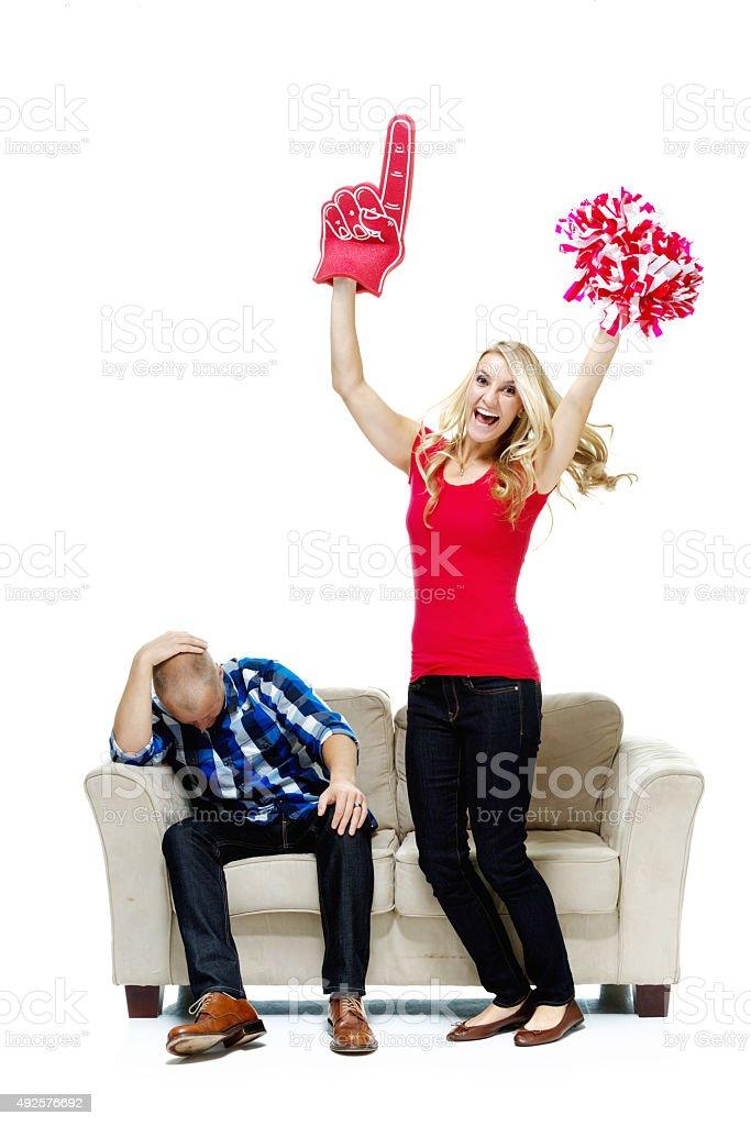Woman celebrating while man upset stock photo