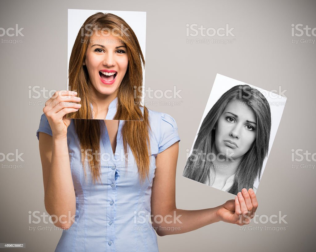 Woman changing her mood stock photo