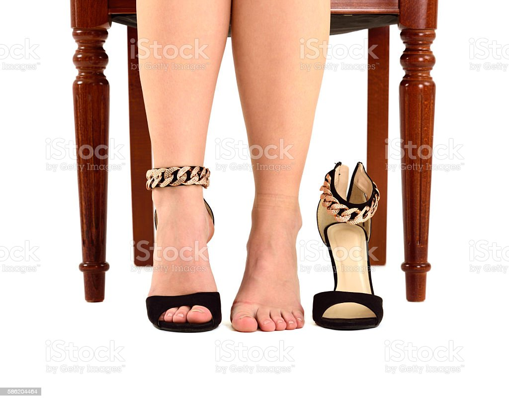 Woman changing shoes, note shoe marks stock photo