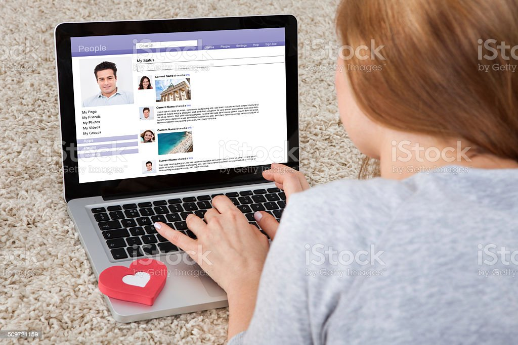 Woman Chatting On Laptop stock photo