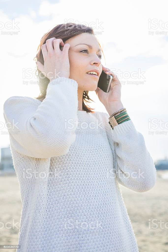 Woman chatting on the phone stock photo