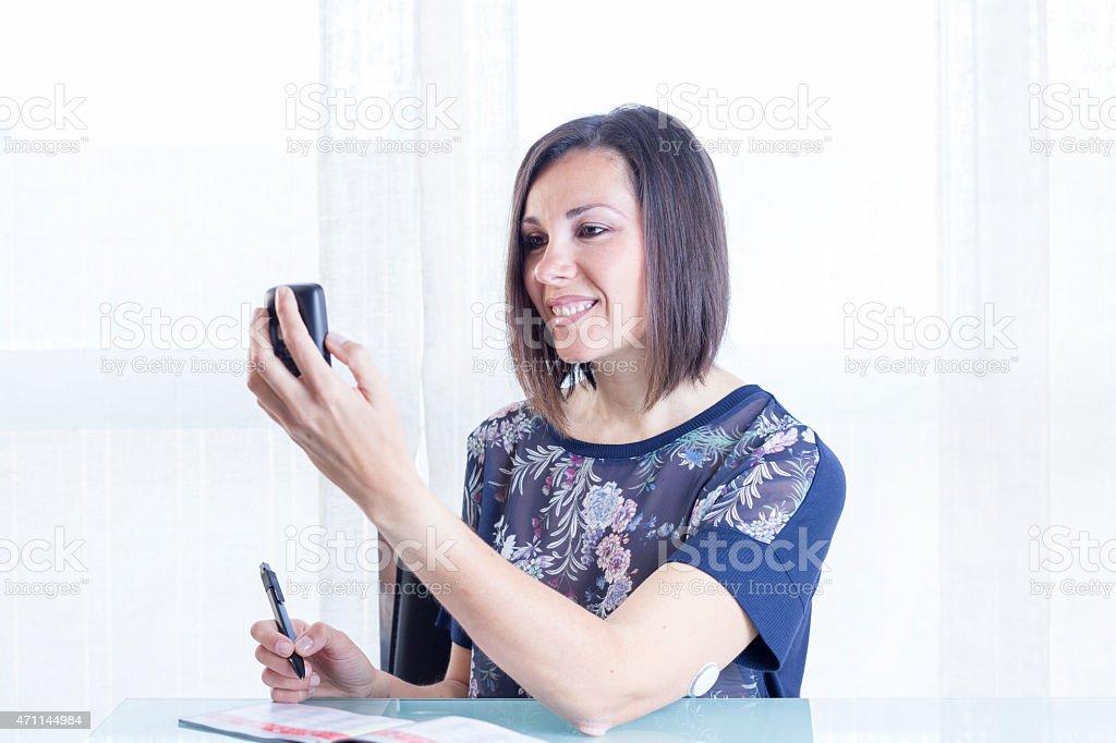 woman checking a reader stock photo