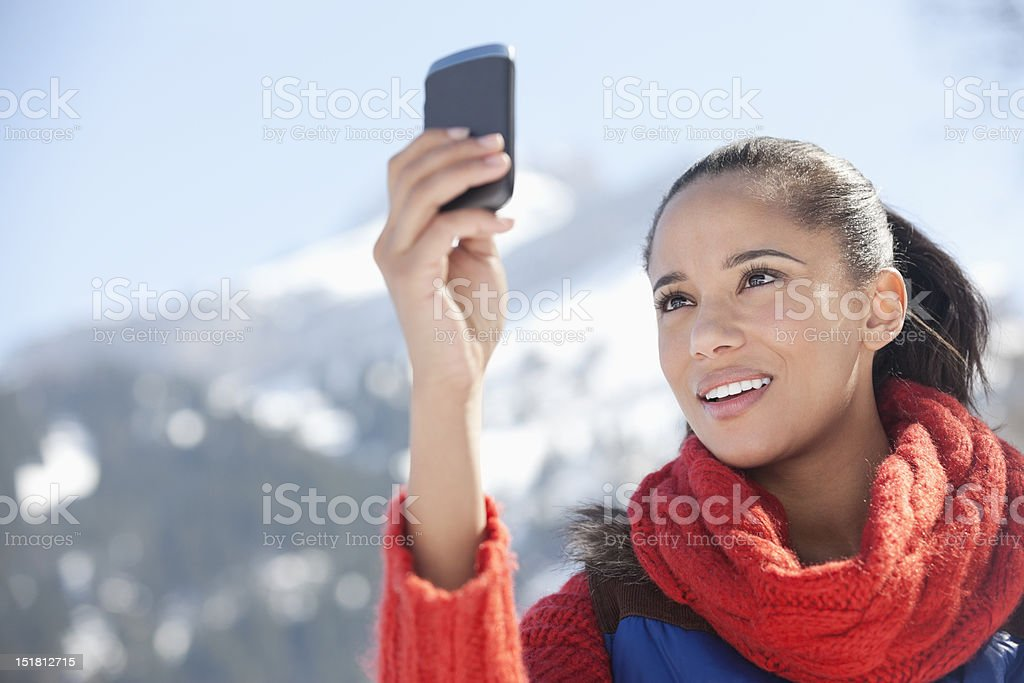 Woman checking cell phone with mountain in background royalty-free stock photo