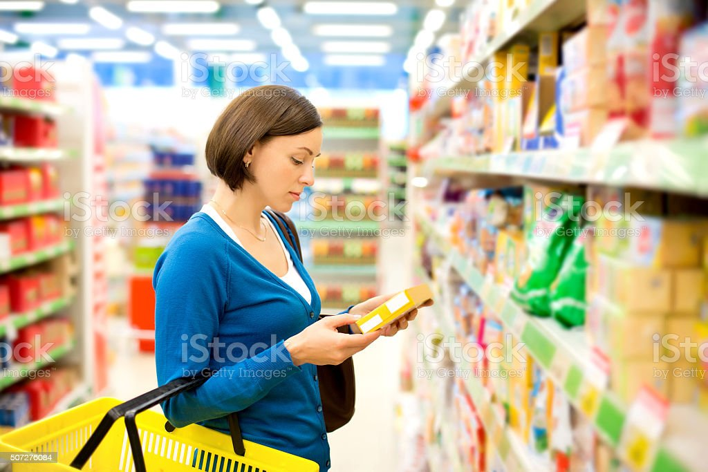 Woman checking food labelling stock photo