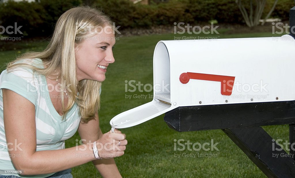 Woman Checking For Mail stock photo