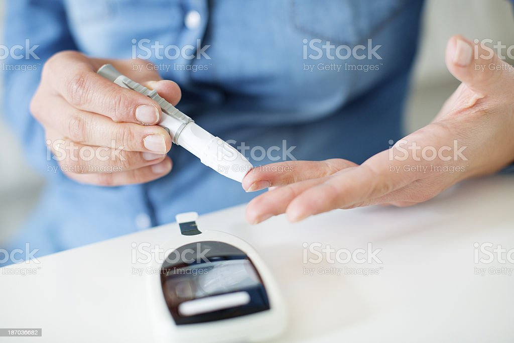 Woman Checking Her Glucose Level. stock photo