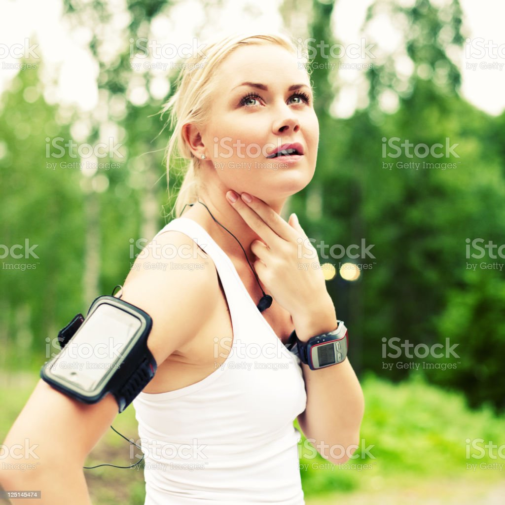 woman checking her pulse royalty-free stock photo