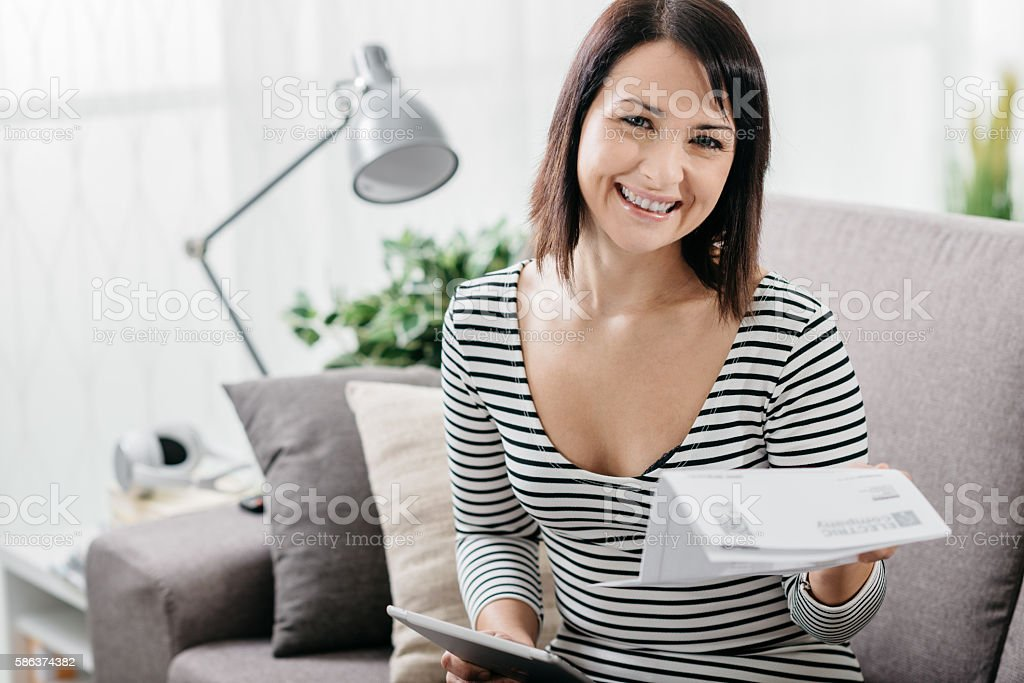Woman checking household bills stock photo