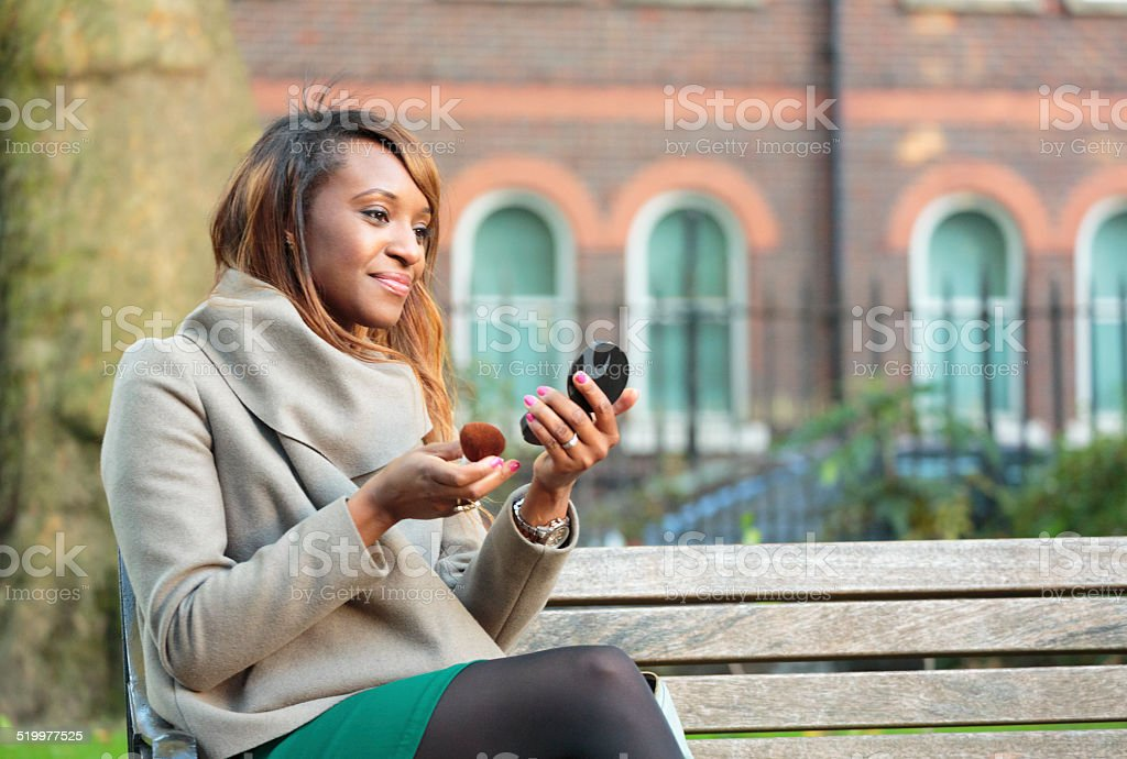 Woman checking makeup stock photo