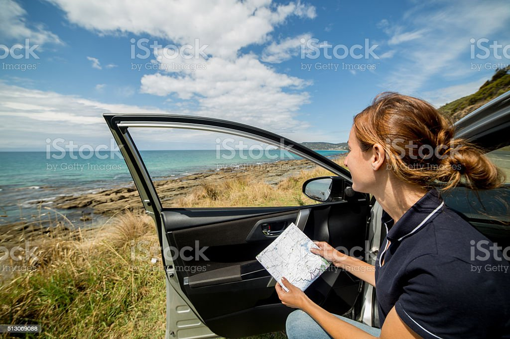 Woman checking map in car stock photo
