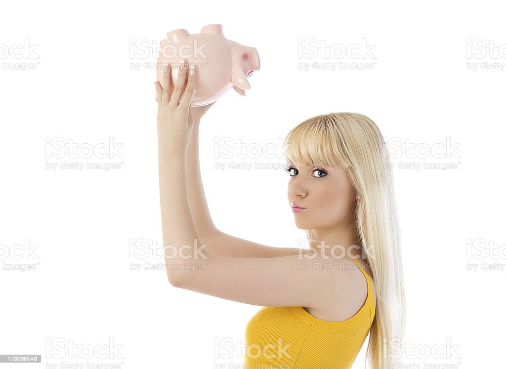Woman checking piggy bank for money royalty-free stock photo