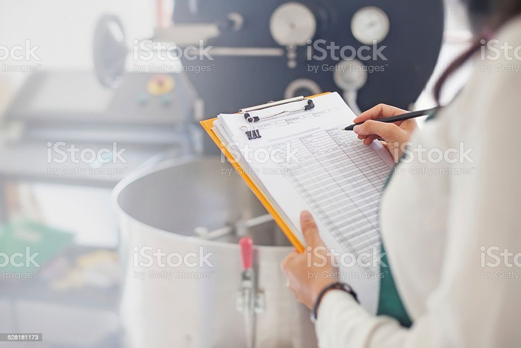 Woman checking quality of coffee stock photo