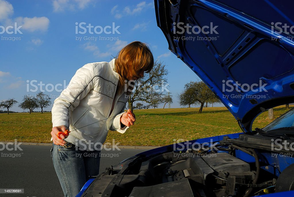 Woman Checking the Motor Oil royalty-free stock photo