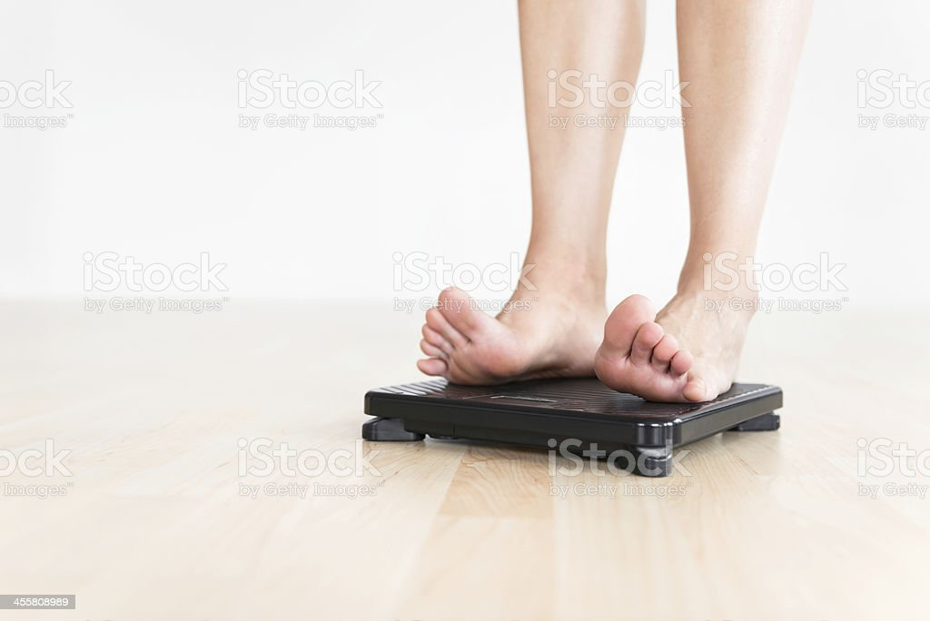 Woman Checking Weight stock photo