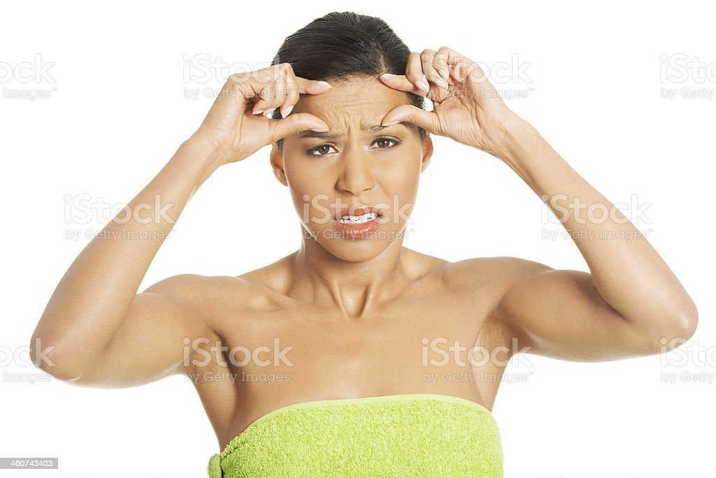 Woman checking  wrinkles on her forehead stock photo