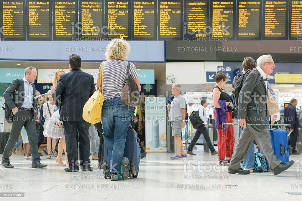 Woman checks the train departure stock photo