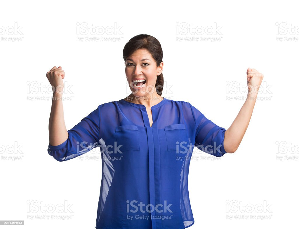 Woman cheering with hands raised stock photo