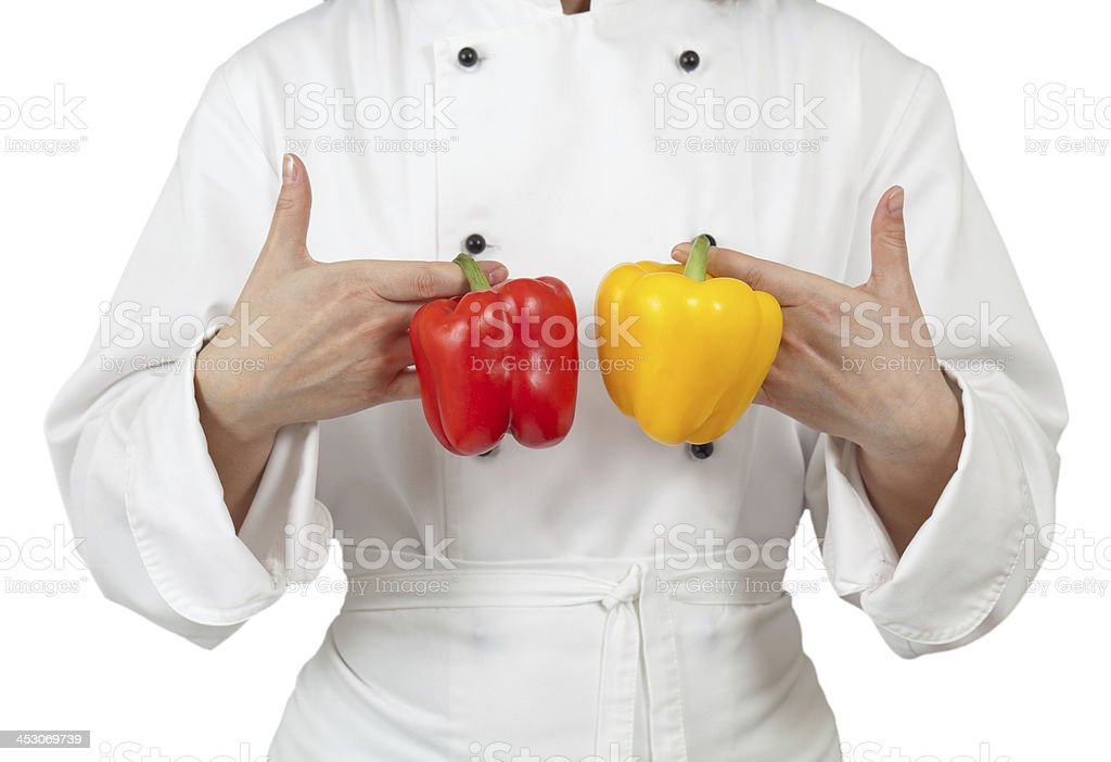 Woman chef in uniform holding a pepper royalty-free stock photo