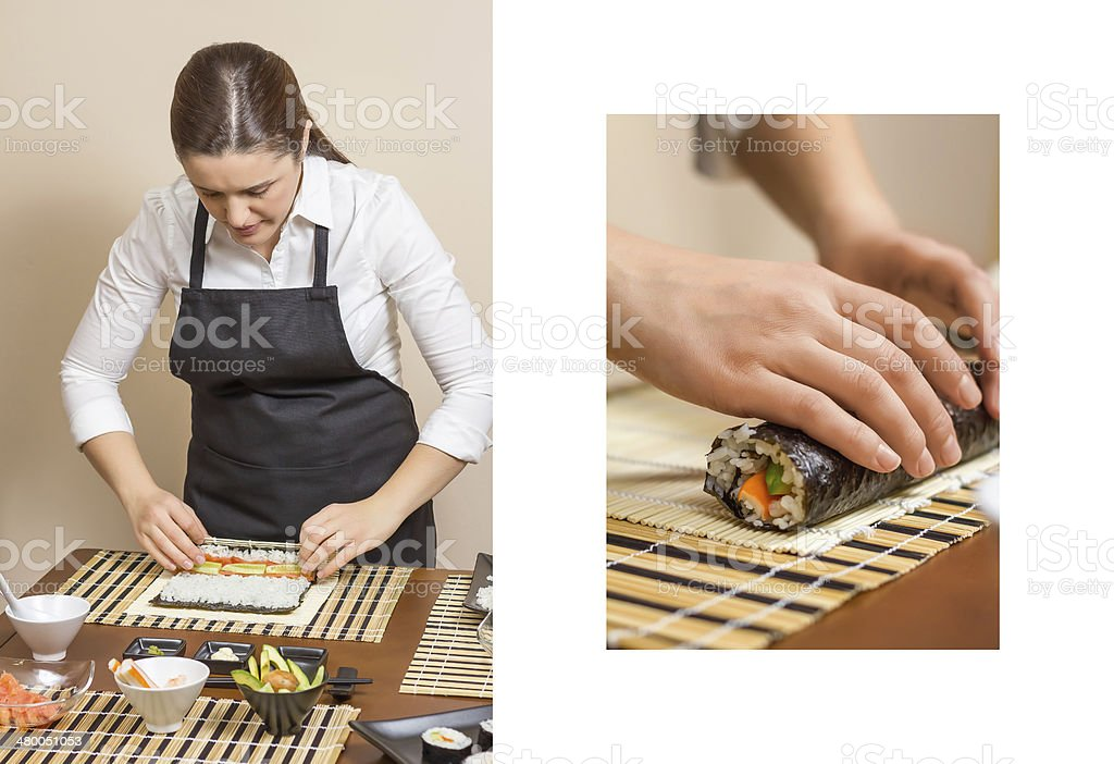Woman chef rolling up sushi and hand work detail royalty-free stock photo