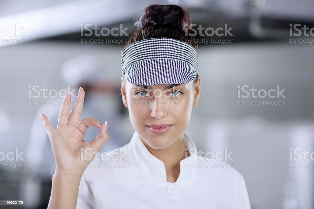 Woman chef showing tumbs up stock photo