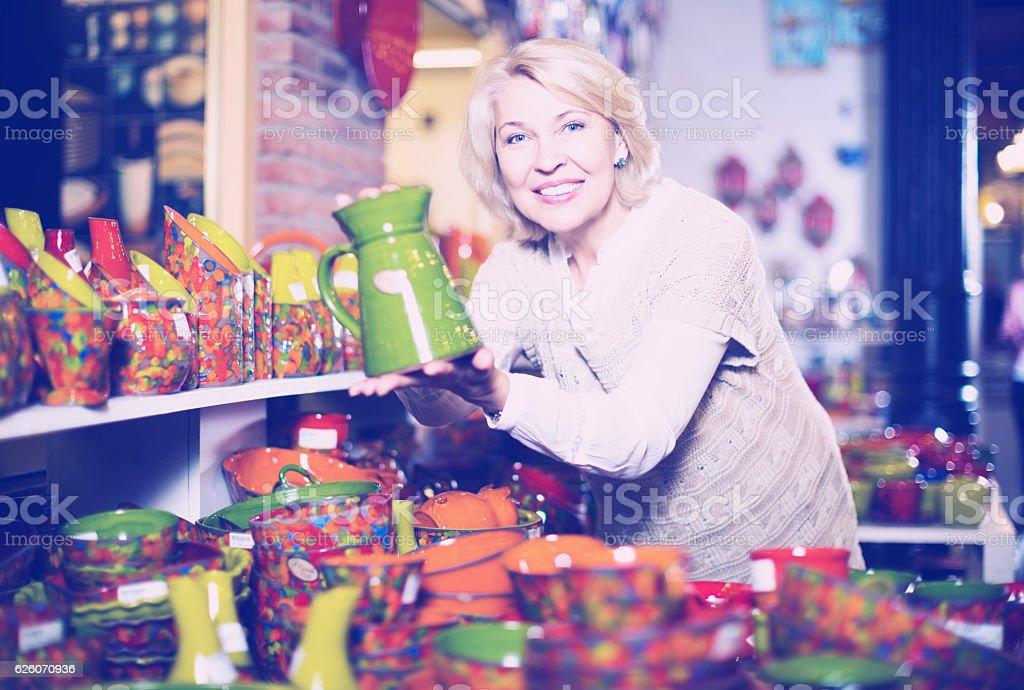 Woman chooses ceramic stock photo