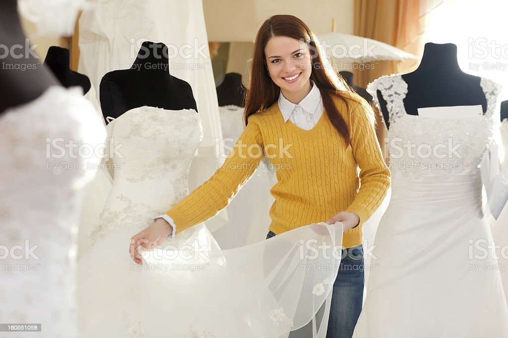 woman chooses wedding gown royalty-free stock photo