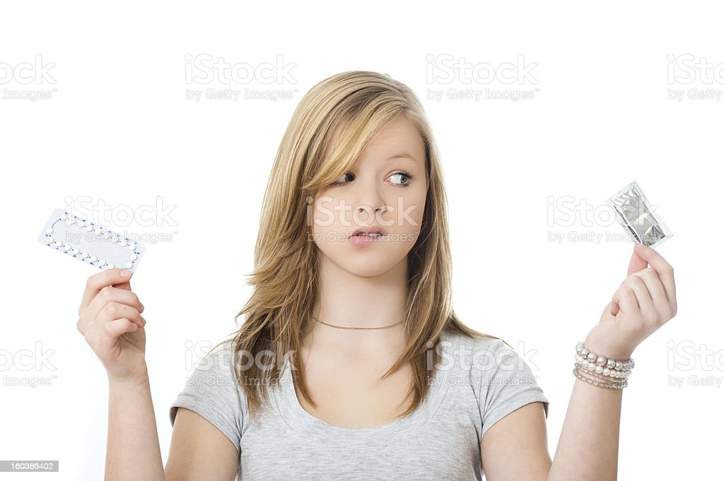 A woman choosing between birth control methods stock photo
