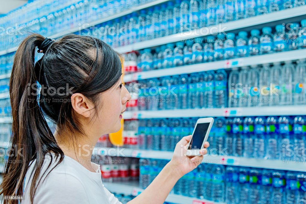 woman choosing bottled water stock photo