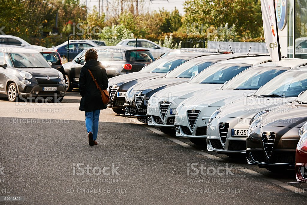 Woman choosing car stock photo