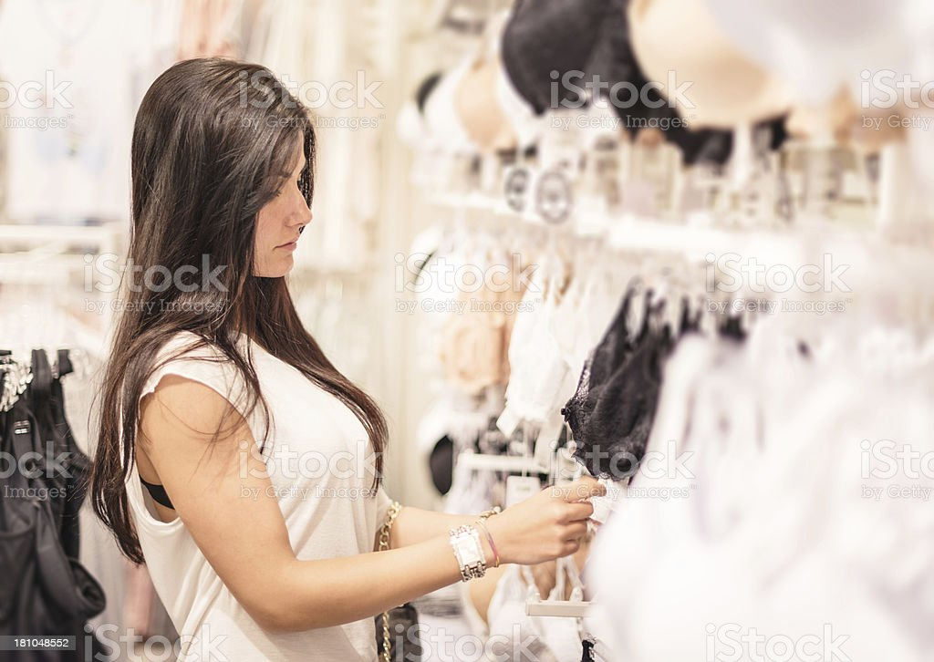 woman choosing clothes at store royalty-free stock photo