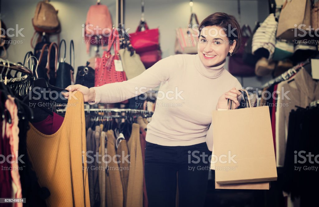 Woman choosing colorful blouse stock photo