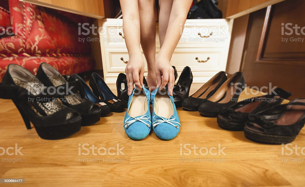 woman choosing comfortable flats rather than high heels royalty-free stock photo