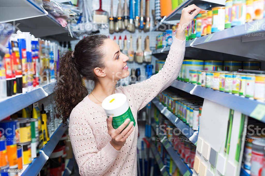 Woman choosing decorating paint stock photo