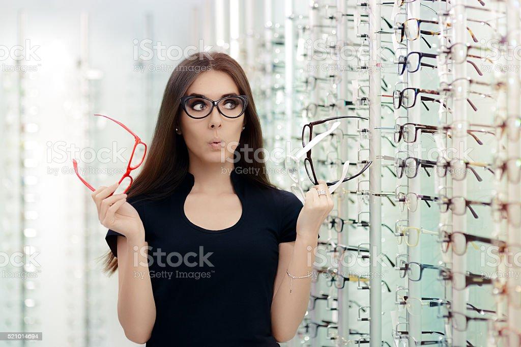 Woman Choosing Eyeglasses Frames in Optical Store stock photo